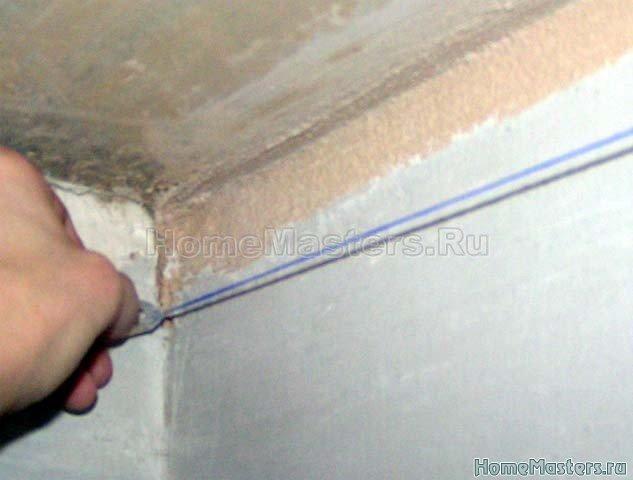 0002 Малярным шнуром отбиваем горизонтальные линии.